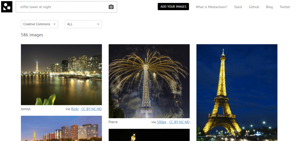 Mediachain attribution engine eiffel tower at night with lights